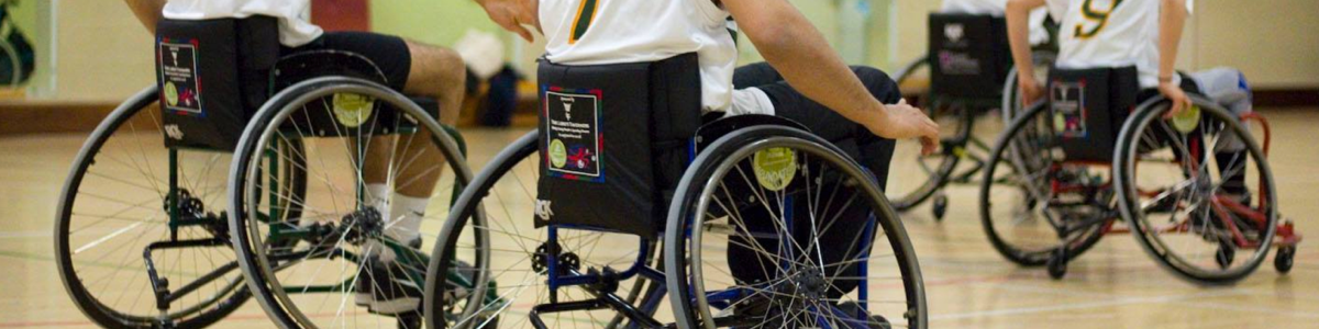 Photo shows wheelchair basketball players